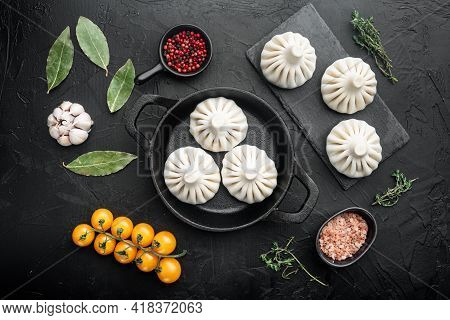 Uncooked Baozi Chinese Dumplings. Azian Dumplings Set, On Black Stone Background, Top View Flat Lay