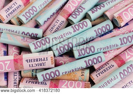 Ukrainian Money Background. Rolls Of Ukrainian Money.