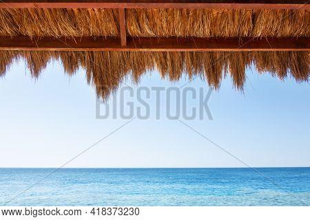 Reed canopy on arbor on beach