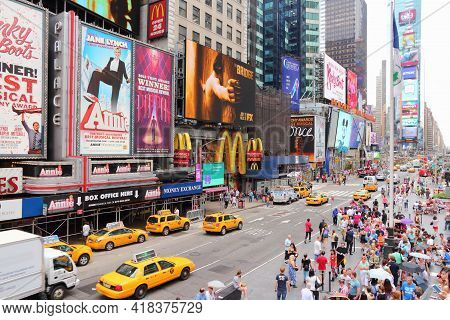 New York, Usa - July 3, 2013: People Visit Times Square In New York. The Square At Junction Of Broad