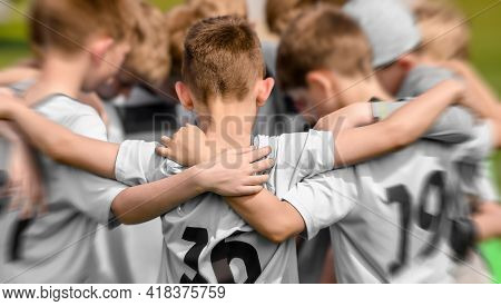 Junior Sports Team Celebrating Winning. Happy Kids Huddling And Standing In Team In A Circle. Boys I