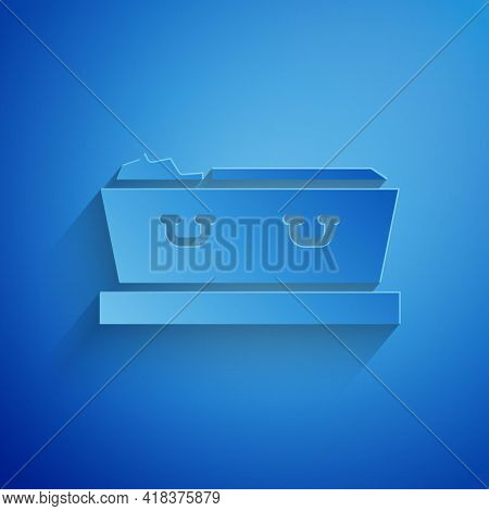 Paper Cut Open Coffin With Dead Deceased Body Icon Isolated On Blue Background. Funeral After Death.
