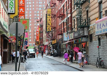 New York, Usa - July 1, 2013: People Visit Chinatown In New York. Nyc Chinatown Has An Estimated Pop