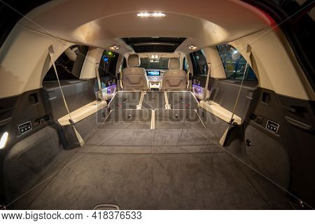 Roomy Empty Interior Of Premium Suv. Rear Seats Folded In Flat Flor In Luxury Expencive Suv Car