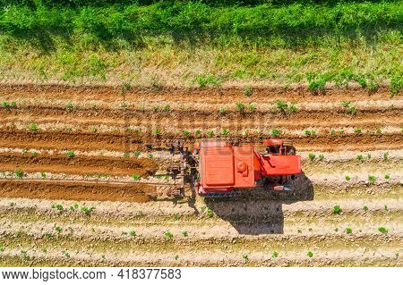 Soil Preparing For The New Crop. Aerial Top View Of Tractor Plowing Ground On Agriculture Farm Field