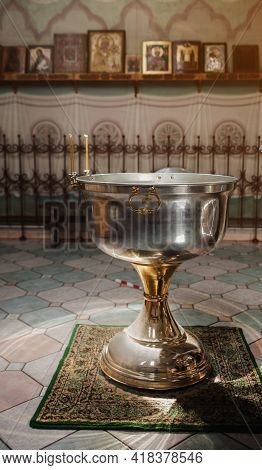 Font For Baptism, An Altar With Icons In The Church. Christian Faith.