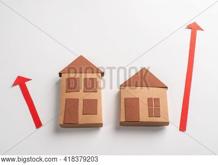 3d Paper Houses And Red Arrows Pointing Up On White Background
