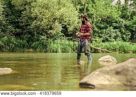 I Choose My Passion. Man Catching Fish. Mature Man Fly Fishing. Fisherman Show Fishing Technique Use