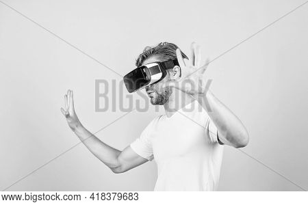 Explore Cyber Space. Man Hipster Virtual Reality Headset On Peach Background. Entertainment And Educ