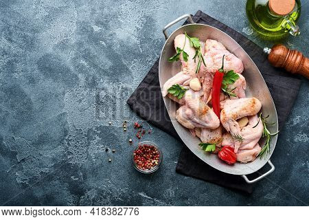Raw Chicken Wings In Metal Pan Or Bowl With Spices And Ingredients For Cooking On Dark Grey Slate, S
