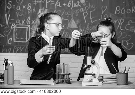 Confident Doctors. Little Girls In School Lab. Biology Education. Science Experiments In Bilogy Labo