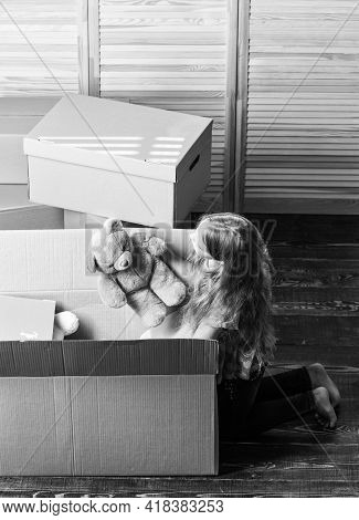 Happy Child Cardboard Box. Repair Of Room. New Apartment. Unpacking Moving Boxes. Cardboard Boxes -