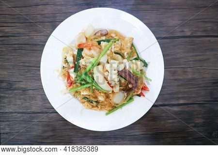 Stir Fried Squid ,shrimp And Vermicelli And Vegetable