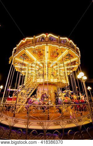 Children's Carousel at an amusement park in the evening and night illumination. amusement park at ni