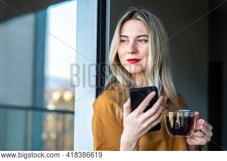 Businesswoman with smartphone, talking video call. Online chat with family, work colleagues, friends. Long distance communication. Staying connected, Social distancing, stay home, internet, Work life.