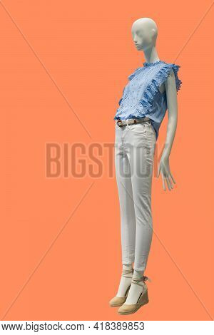 Full Length Image Of A Female Display Mannequin Wearing Fashionable Summer Clothes Isolated On An Or