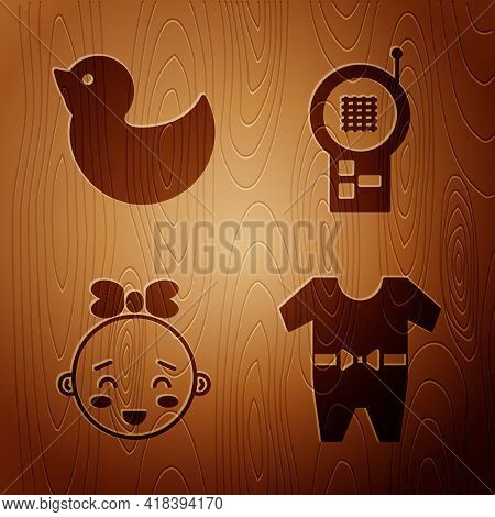 Set Baby Clothes, Rubber Duck, Happy Little Girl Head And Baby Monitor Walkie Talkie On Wooden Backg