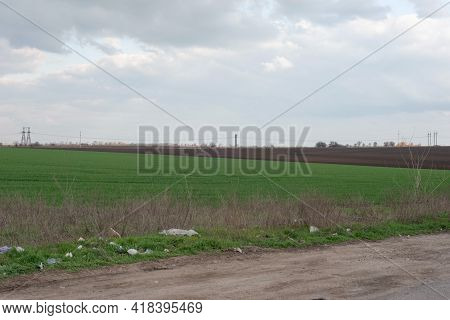 Trash Roadside Minimalistic Village Landscape Green Grass Field Polluted With Waste Plastic Roadside