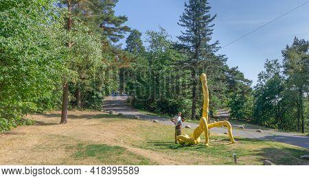 Oslo, Norway - July 2018, Ekebergparken Sculpture Park. Tourists See The Deep Cream Maradona Sculptu