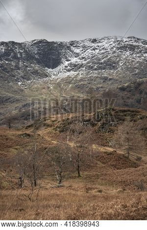 Epic Winter Landscape Image View From Holme Fell In Lake District Towards Snow Capped Mountain Range