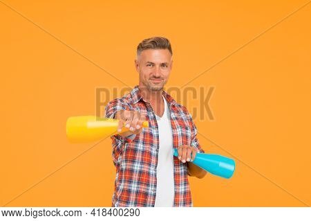 Clean House. Happy Man Hold Household Sprays. Cleaning House With Disinfectant Sprayers. Cleaner Spr