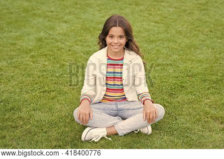 Relax At School Yard. Kid Relaxing Outdoors. Peace Of Mind. School Break For Rest. Adorable Pupil. G