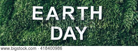 Inscription Earth Day. Biophilia Concept. Nature Backdrop. Word Earth Day On Moss, Green Grass Backg