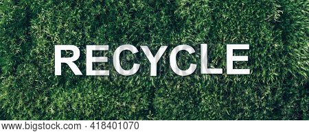Word Recycle On Moss, Green Grass Background. Top View. Copy Space. Banner. Biophilia Concept. Natur