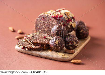 Various Handmade Chocolate, Cacao Vegan Sweet Dessert, Energy Balls On Wooden Board Background. Heal