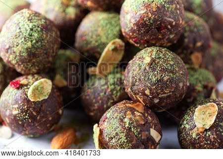 Raw Energy Balls With Matcha Tea Powder On Grey Background. Raw Vegan, Vegetarian Sweets. Sugar Free