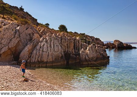 Stara Baska, Croatia - July, 21: Child In The Oprna Beach On July 21, 2020