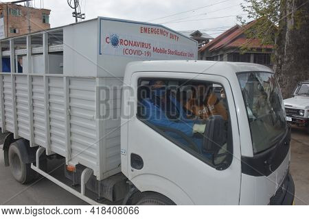 Covid Fumigation Vehicles Trucks And Frontline Heroes Wearing White Kits On Streets Empty Roads Of S
