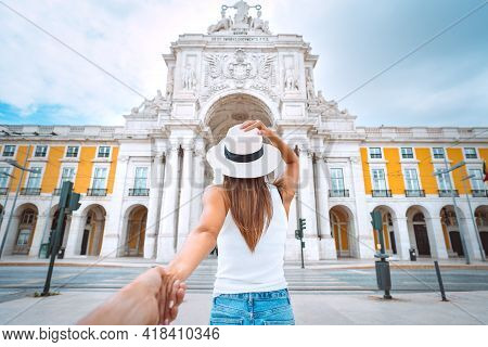 Tourist Woman Leading Man. Follow Me. Couple On Vacation. Traveling Together. Commerce Square With R