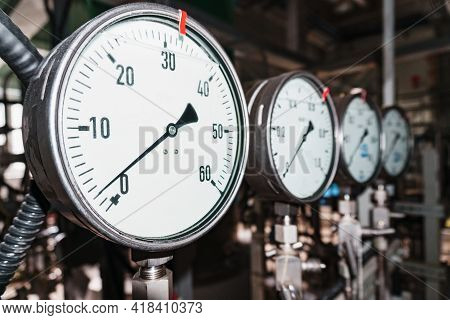 Pressure Gauge Is A Close-up Pressure Measuring Device In A Row.