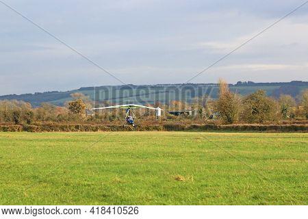 Ultralight Airplane Landing On A Grass Strip