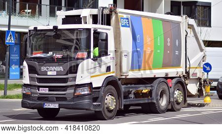 Warsaw, Poland. 26 April 2021. Garbage Truck On The Street. Municipal And City Services.
