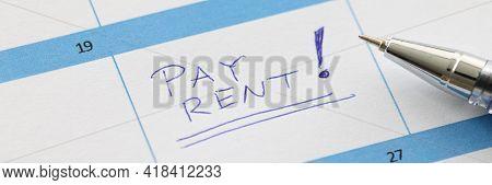 Pay Rent Is Written On Sheet Of Calendar With Ballpoint Pen Closeup