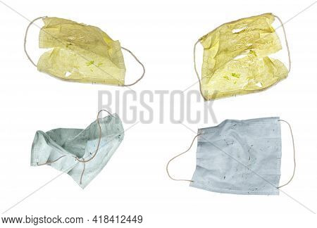 Four Colored Paper Covid Masks Ready For The Garbage, Isolated On White For Your Easy Extraction.