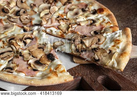 Sliced Pizza With Ham And Mushrooms, Homemade Thin Crust Pizza On The Wooden Board, Selective Focus