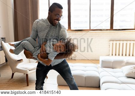 Happy Excited Dad Enjoying Active Playtime With Cute Preschooler Son