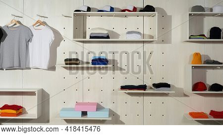 Assortment Of Colorful Cotton Sport Clothes Laid Out On The Shelves In The Store. Custom Wear At Clo
