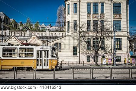 Budapest, Hungary, March 2020, View Of A Tram Passing By A Building In Lehel Street