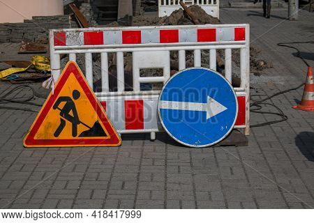 Road Signs On The Road. Renovation Work Sign. Road Repair. Detour Sign During The Elimination Of The