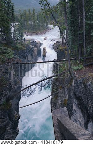 Vertical Shot Of Sunwapta Falls In Jasper National Park On A Dark And Cloudy Day. Harsh Weather In C