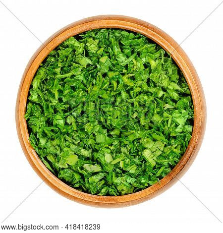 Chopped Parsley, In A Wooden Bowl. Fresh, Flat Leaved Parsley, Green Leaves Of Petroselinum Crispum,