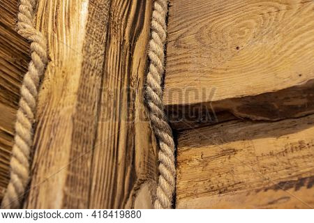 Wooden Planks And Rope Close Up In Retro Style