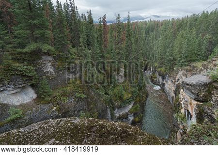 Wild River Flows Swiftly Between Steep Cliffs Of Maligne Canyon In Jasper National Park, Alberta, Ca