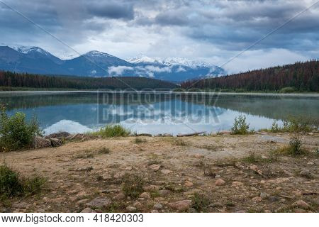 Clouds Gather Above Patricia Lake In Canadian Rockies On A Cold Summer Evening. Dusk In Jasper Natio