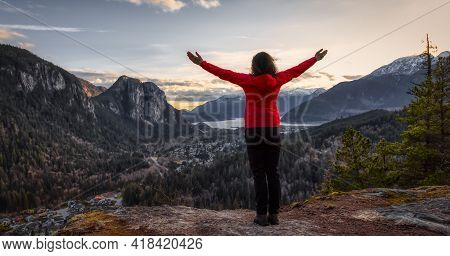 Adventurous Woman Hiking In The Mountains During A Spring Sunset. Taken Squamish, North Of Vancouver
