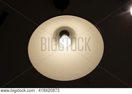 Round Glowing Lamp On The Ceiling In The Dark Close Up